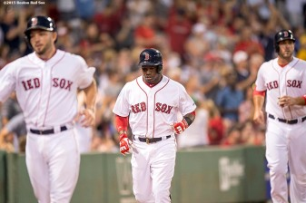 """Boston Red Sox catcher Blake Swihart, right fielder Rusney Castillo, and first baseman Travis Shaw run toward the dugout after scoring on a bases clearing double by center fielder Mookie Betts during the second inning of a game against the Cleveland Indians at Fenway Park in Boston, Massachusetts Tuesday, August 18, 2015."""