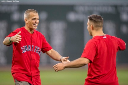 """Jimmy Fund patient Donnie Lewis meets his organ donor Daniel Alcantor for the first time as they throw out the ceremonial first pitch before a game between the Boston Red Sox and the Cleveland Indians at Fenway Park in Boston, Massachusetts Tuesday, August 18, 2015."""
