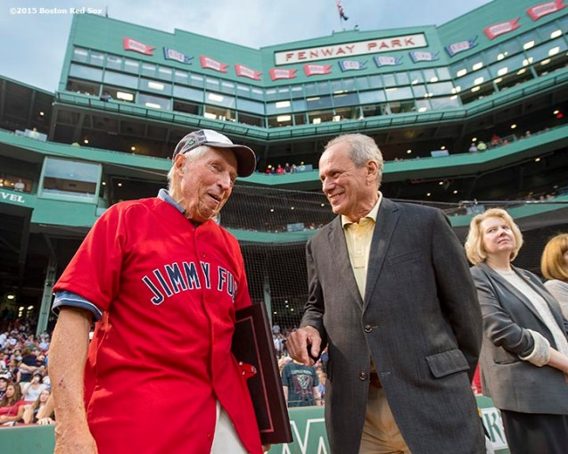 """Boston Red Sox President & CEO Larry Lucchino greets the 2015 Jimmy Fund Award recipient before a game between the Boston Red Sox and the Cleveland Indians at Fenway Park in Boston, Massachusetts Tuesday, August 18, 2015."""