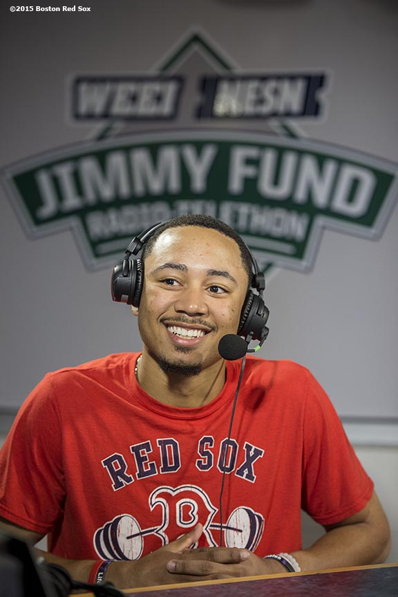 """Boston Red Sox center fielder Mookie Betts appears on set during the WEEI NESN Jimmy Fund Radio-Telethon at Fenway Park in Boston, Massachusetts Tuesday, August 18, 2015."""