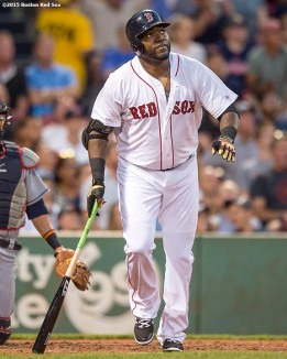 """Boston Red Sox designated hitter David Ortiz hits a home run during the second inning of a game against the Cleveland Indians at Fenway Park in Boston, Massachusetts Wednesday, August 19, 2015."""