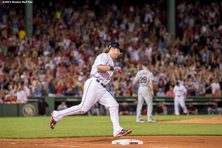 """Boston Red Sox catcher Ryan Hanigan rounds first base after hitting a home run during the fifth inning of a game against the Cleveland Indians at Fenway Park in Boston, Massachusetts Wednesday, August 19, 2015."""