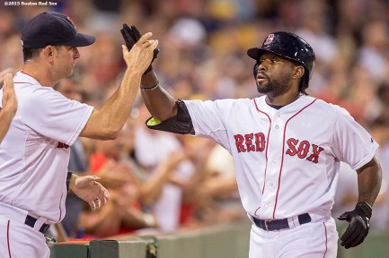 """Boston Red Sox center fielder Jackie Bradley Jr. high fives interim manager Torey Lovullo after hitting a solo home run during the fifth inning of a game against the Cleveland Indians at Fenway Park in Boston, Massachusetts Wednesday, August 19, 2015."""