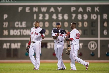 """Boston Red Sox left fielder Alejandro De Aza, center fielder Jackie Bradley Jr., and right fielder Rusney Castillo high five after defeating the Cleveland Indians at Fenway Park in Boston, Massachusetts Wednesday, August 19, 2015."""