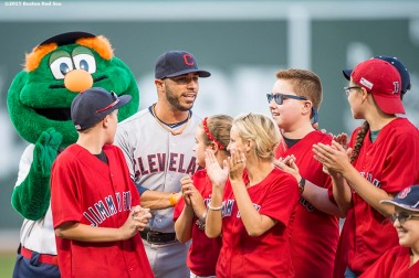 """Cleveland Indians third baseman Mike Avles joins Jimmy Fund patients on the mound for a ceremonial first pitch before a game between the Boston Red Sox and the Cleveland Indians at Fenway Park in Boston, Massachusetts Wednesday, August 19, 2015."""