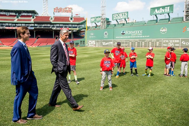 """Newly appointed Boston Red Sox President of Baseball Operations Dave Dombrowski walks on the field with his son Landon during a Sox Talk clinic at Fenway Park in Boston, Massachusetts Wednesday, August 19, 2015."""
