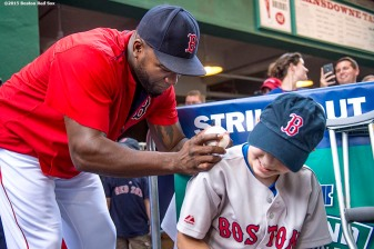 """Boston Red Sox designated hitter David Ortiz signs autographs for a Jimmy Fund patient during the WEEI NESN Jimmy Fund Radio-Telethon at Fenway Park in Boston, Massachusetts Wednesday, August 19, 2015."""