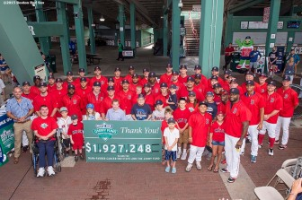 August 19, 2015, Boston, MA: Members of the Boston Red Sox pose for a team photograph with Jimmy Fund patients during the WEEI NESN Jimmy Fund Radio-Telethon at Fenway Park in Boston, Massachusetts Wednesday, August 19, 2015. (Photo by Billie Weiss/Boston Red Sox)