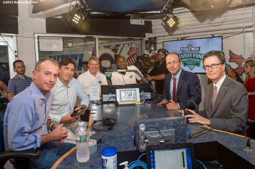 August 19, 2015, Boston, MA: Boston Bruins owner Charlie Jacobs , Boston Celtics owner Wyc Grousbeck, New England Patriots and New England Revolution owner Jonathan Kraft and Boston Red Sox owner John Henry pose for a group photograph as they appear on set during the WEEI NESN Jimmy Fund Radio-Telethon at Fenway Park in Boston, Massachusetts Wednesday, August 19, 2015. (Photo by Billie Weiss/Boston Red Sox)