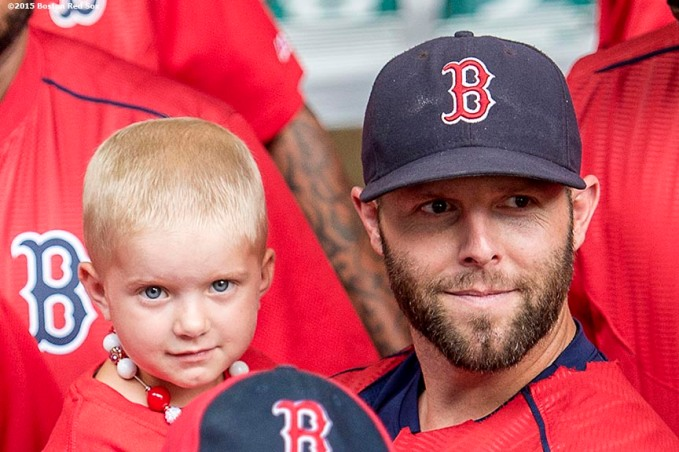 August 19, 2015, Boston, MA: Boston Red Sox second baseman Dustin Pedroia greets a Jimmy Fund patient during the WEEI NESN Jimmy Fund Radio-Telethon at Fenway Park in Boston, Massachusetts Wednesday, August 19, 2015. (Photo by Billie Weiss/Boston Red Sox)