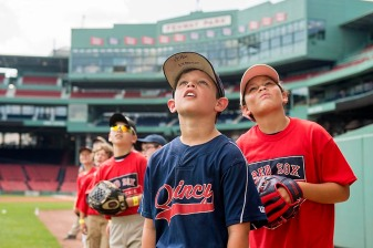 """Participants watch as a ball is hit off the green monster during a Sox Talk clinic at Fenway Park in Boston, Massachusetts Wednesday, August 19, 2015."""