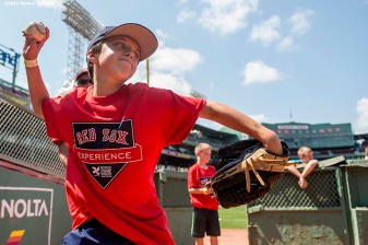 """A participant takes part in a pitching clinic in the bullpen during a Sox Talk clinic at Fenway Park in Boston, Massachusetts Wednesday, August 19, 2015."""