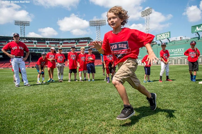 """A participant takes part in a base running drill during a Sox Talk clinic at Fenway Park in Boston, Massachusetts Wednesday, August 19, 2015."""