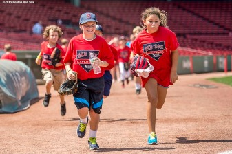 """Participants run during a Sox Talk clinic at Fenway Park in Boston, Massachusetts Wednesday, August 19, 2015."""