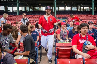 """Boston Red Sox second baseman Dustin Pedroia signs autographs during a Jimmy Fund meet and greet at Fenway Park in Boston, Massachusetts Saturday, August 22, 2015."""