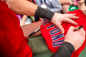 """A jersey is autographed during a Jimmy Fund meet and greet at Fenway Park in Boston, Massachusetts Saturday, August 22, 2015."""
