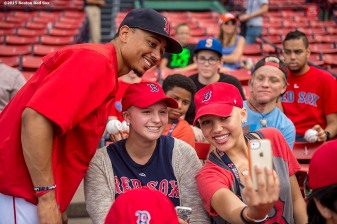 """Boston Red Sox center fielder Mookie Betts poses for a selfie photograph during a Jimmy Fund meet and greet at Fenway Park in Boston, Massachusetts Saturday, August 22, 2015."""