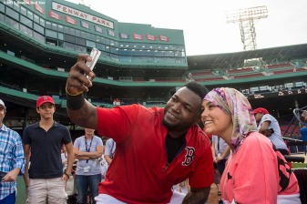 """Boston Red Sox designated hitter David Ortiz poses for a selfie photograph during a Jimmy Fund meet and greet at Fenway Park in Boston, Massachusetts Saturday, August 22, 2015."""