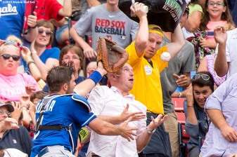 """Kansas City Royals catcher Drew Butera attempts to catch a foul ball during the first inning of a game against the Boston Red Sox at Fenway Park in Boston, Massachusetts Sunday, August 23, 2015."""
