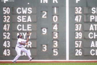 """""""Bosotn Red Sox left fielder Jackie Bradley Jr. plays a ball off the wall during the ninth inning of a game against the Kansas City Royals at Fenway Park in Boston, Massachusetts Sunday, August 23, 2015."""""""