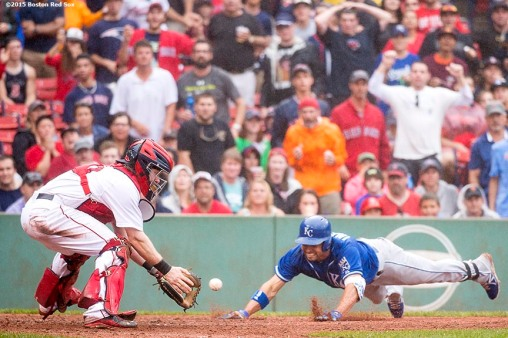 """Bosotn Red Sox catcher Ryan Hanigan applies a tag during the ninth inning of a game against the Kansas City Royals at Fenway Park in Boston, Massachusetts Sunday, August 23, 2015."""