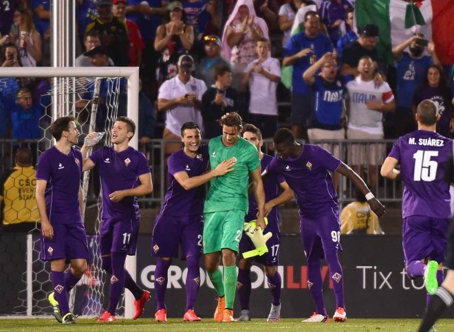 EAST HARTFORD, CT - JULY 24: Members of ACF Fiorentina react with Luca Lezzerini #24 after he saved a penalty kick to defeat SL Benfica during an International Champions Cup 2015 match at Rentschler Field on July 24, 2015 in East Hartford, Connecticut. (Photo by Billie Weiss/Getty Images) *** Local Caption *** Luca Lezzerini