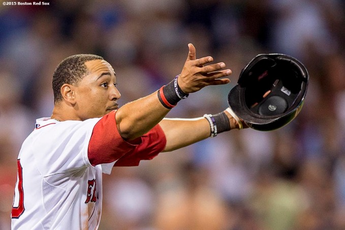"""Boston Red Sox center fielder Mookie Betts reacts during an umpire's review after being tagged out attempting to steal third base during the eighth inning of a game against the New York Yankees at Fenway Park in Boston, Massachusetts Tuesday, September 1, 2015."""