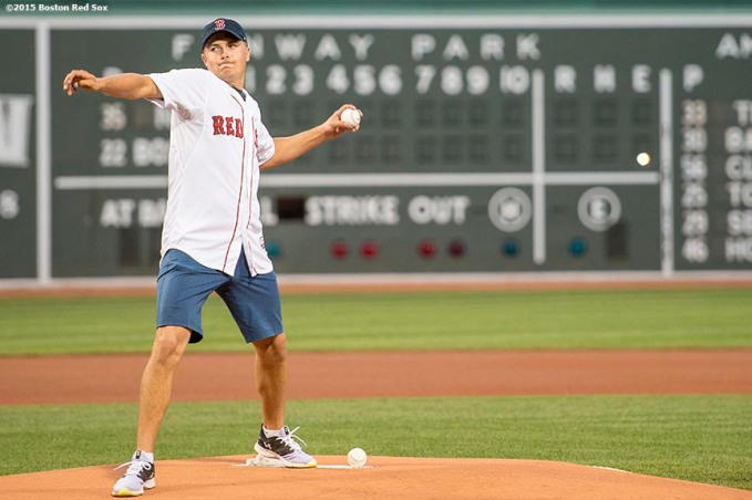 """PGA tour golfer Jordan Spieth throws out the ceremonial first pitch before a game between the Boston Red Sox and the New York Yankees at Fenway Park in Boston, Massachusetts Tuesday, September 1, 2015."""
