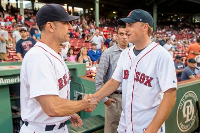 """PGA tour golfer Jordan Spieth meets Boston Red Sox interim manager Torey Lovullo before throwing out the ceremonial first pitch before a game between the Boston Red Sox and the New York Yankees at Fenway Park in Boston, Massachusetts Tuesday, September 1, 2015."""