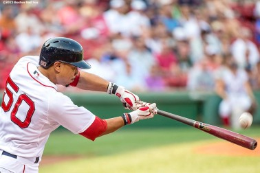 """Boston Red Sox center fielder Mookie Betts hits a double during the first inning of a game against the New York Yankees at Fenway Park in Boston, Massachusetts Wednesday, September 2, 2015."""
