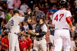 """New York Yankees pitcher Andrew Miller and catcher Brian McCann high five after defeating the Boston Red Sox at Fenway Park in Boston, Massachusetts Wednesday, September 2, 2015."""
