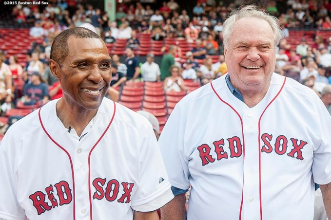 """2015 NBA Hall of Fame inductees Tommy Heinsohn and Jo Jo White react before throwing out a ceremonial first pitch before a game between the Boston Red Sox and the New York Yankees at Fenway Park in Boston, Massachusetts Wednesday, September 2, 2015."""