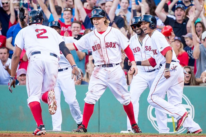 """""""Boston Red Sox shortstop Xander Bogaerts reacts with third baseman Brock Holt, designated hitter David Ortiz, left fielder Jackie Bradley Jr., and center fielder Mookie Betts after he scores on an error after an RBI triple during the fourth inning of a game against the Philadelphia Phillies at Fenway Park in Boston, Massachusetts Saturday, September 5, 2015."""""""
