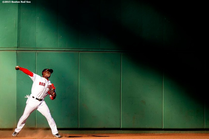 """""""Boston Red Sox left fielder Rusney Castillo throws to the infield as and center fielder Mookie Betts looks on during the sixth inning of a game against the Philadelphia Phillies at Fenway Park in Boston, Massachusetts Saturday, September 5, 2015."""""""