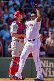 """Boston Red Sox designated hitter David Ortiz reacts after hitting a solo home run during the first inning of a game against the Philadelphia Phillies at Fenway Park in Boston, Massachusetts Sunday, September 6, 2015. It was home run number 497 of his career. """