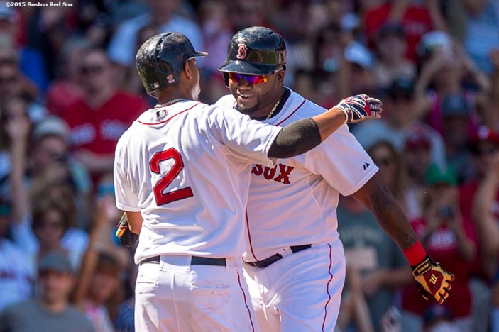 """Boston Red Sox designated hitter David Ortiz hugs shortstop Xander Bogaerts after hitting a solo home run during the first inning of a game against the Philadelphia Phillies at Fenway Park in Boston, Massachusetts Sunday, September 6, 2015. It was home run number 497 of his career. """