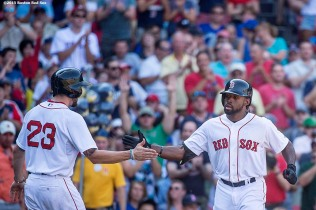 """Boston Red Sox right fielder Jackie Bradley Jr. high fives catcher Blake Swihart after hitting a two run home run during the sixth inning of a game against the Toronto Blue Jays at Fenway Park in Boston, Massachusetts Monday, September 7, 2015."""