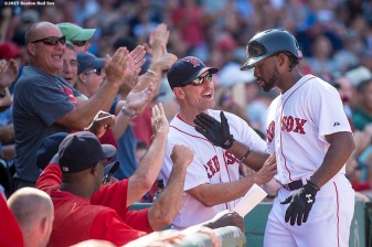 """Boston Red Sox right fielder Jackie Bradley Jr. high fives interim manager Torey Lovullo after hitting a two run home run during the sixth inning of a game against the Toronto Blue Jays at Fenway Park in Boston, Massachusetts Monday, September 7, 2015."""
