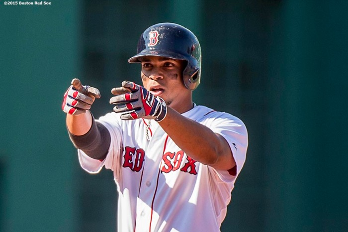 """""""Boston Red Sox shortstop Xander Bogaerts reacts after hitting a double during the sixth inning of a game against the Toronto Blue Jays at Fenway Park in Boston, Massachusetts Monday, September 7, 2015."""""""