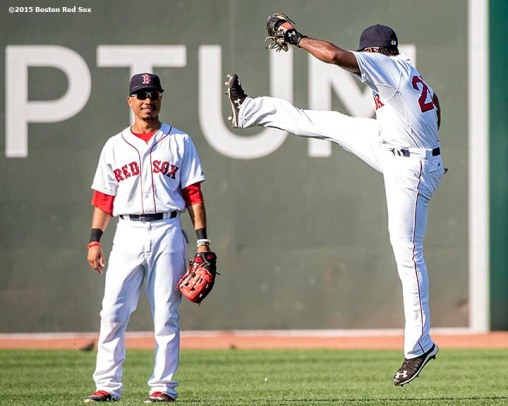 """Boston Red Sox center fielder Mookie Betts and right fielder Jackie Bradley Jr. react after defeating the Toronto Blue Jays at Fenway Park in Boston, Massachusetts Monday, September 7, 2015."""