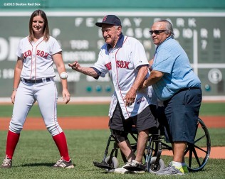 """Former Boston Red Sox third baseman Frank Malzone throws out the ceremonial first pitch before a game between the Boston Red Sox and the Toronto Blue Jays at Fenway Park in Boston, Massachusetts Monday, September 7, 2015."""