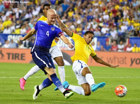 FOXBORO, MA - SEPTEMBER 08: Michael Bradley #4 of the United States takes a shot on goal as he is defended by Marquinhos #13 of Brazil during an international friendly at Gillette Stadium on September 8, 2015 in Foxboro, Massachusetts. (Photo by Billie Weiss/Getty Images)