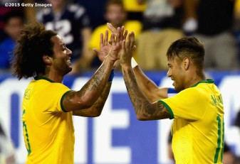 FOXBORO, MA - SEPTEMBER 08: Marcelo #6 and Neymar #10 of Brazil react after Neymar scored a goal during an international friendly against the United States at Gillette Stadium on September 8, 2015 in Foxboro, Massachusetts. (Photo by Billie Weiss/Getty Images)