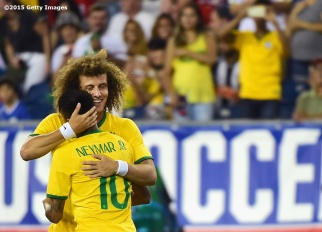 FOXBORO, MA - SEPTEMBER 08: David Luiz #4 hugs Neymar #10 of Brazil after scoring a goal during an international friendly against the United States at Gillette Stadium on September 8, 2015 in Foxboro, Massachusetts. (Photo by Billie Weiss/Getty Images)
