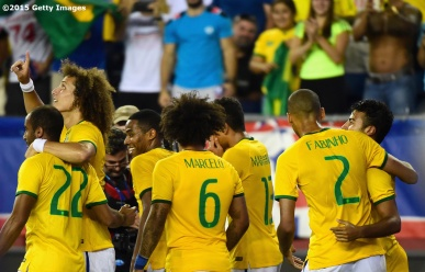 FOXBORO, MA - SEPTEMBER 08: Members of Brazil react after a goal during an international friendly against the United States at Gillette Stadium on September 8, 2015 in Foxboro, Massachusetts. (Photo by Billie Weiss/Getty Images)