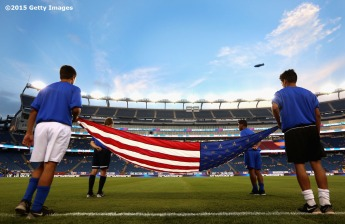 FOXBORO, MA - SEPTEMBER 08: A flag is prepared before an international friendly between the United States and Brazil at Gillette Stadium on September 8, 2015 in Foxboro, Massachusetts. (Photo by Billie Weiss/Getty Images)