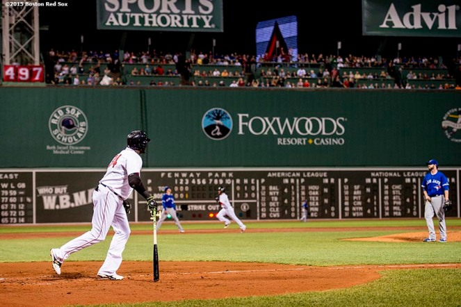 """Boston Red Sox designated hitter David Ortiz hits a three run home run during the third inning of a game against the Toronto Blue Jays at Fenway Park in Boston, Massachusetts Monday, September 9, 2015. It was home run number 498 of his career."""