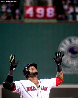 """Boston Red Sox designated hitter David Ortiz reacts after hitting a three run home run during the third inning of a game against the Toronto Blue Jays at Fenway Park in Boston, Massachusetts Monday, September 9, 2015. It was home run number 498 of his career. """