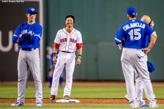 """""""Boston Red Sox center fielder Mookie Betts reacts after hitting a double that was overturned into a solo home run during the third inning of a game against the Toronto Blue Jays at Fenway Park in Boston, Massachusetts Monday, September 9, 2015."""""""