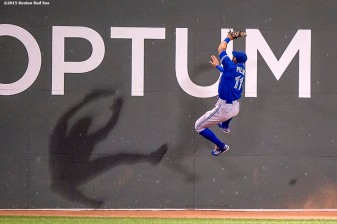 """Toronto Blue Jays center fielder Kevin Pillar leaps as he attempts to catch a fly ball during the fourth inning of a game against the Boston Red Sox at Fenway Park in Boston, Massachusetts Monday, September 9, 2015."""